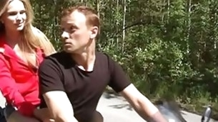 Guy and knockout are riding motorbike feeling strong bait to have bad pounding